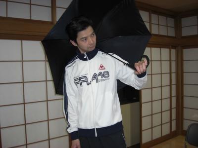 傘さす魔人