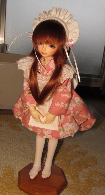 桜柄着物でぺこり